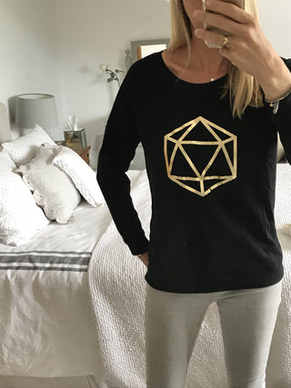 Metallic gold octahedron on black sweat