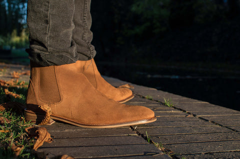 A pair of brown suede Hamilton boots paired with a pair of black jeans