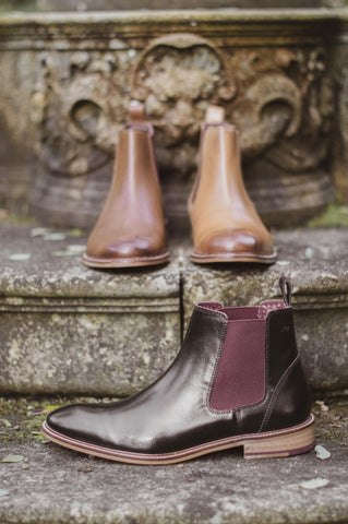 three shoes on some gothic stones steps, each a different coloured version of the same leather hamilton chelsea boot