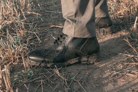 black mens brogue billy boots in field