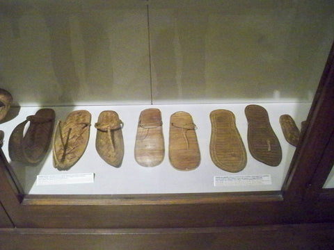 A display case in a museum with ancient Flip-flops