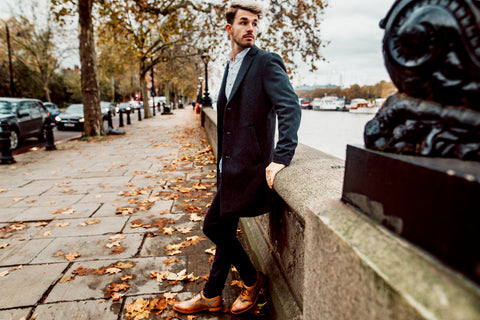 Man in wool coat and smart shirt with dark chinos and shelby oxford london brogue shoes in tan and tweed
