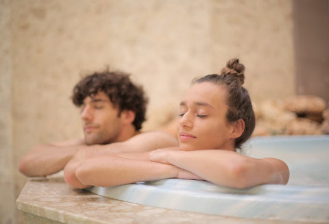 couple at a spa enjoying the jacuzzi