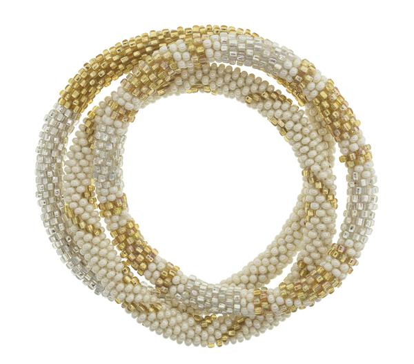 Aid Through Trade roll-on glass bead bracelet in gold and cream. Handmade in Nepal.