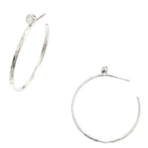 Hand hammered silver hoop earrings with moon glass