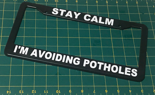 STAY CALM - I'M AVOIDING POTHOLES License Plate Frame