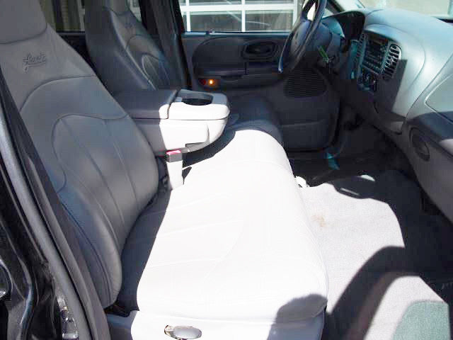Ford F-150/250/350 40/60 Seats with Molded Headrests and a 2 Cup Console