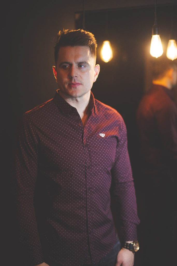 Patrick Greene modelling the Burgundy Clarendon Shirt - Dark Background
