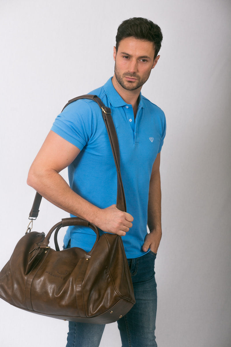 Man wearing light blue Polo Shirt With Shoulder Bag
