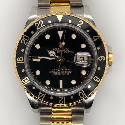 Rolex GMT  Master II Black 18kt. & Steel Oyster Band
