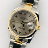 Rolex Datejust 36mm Roulette Calendar Roman Dial 18kt & Steel Oyster Band 126203