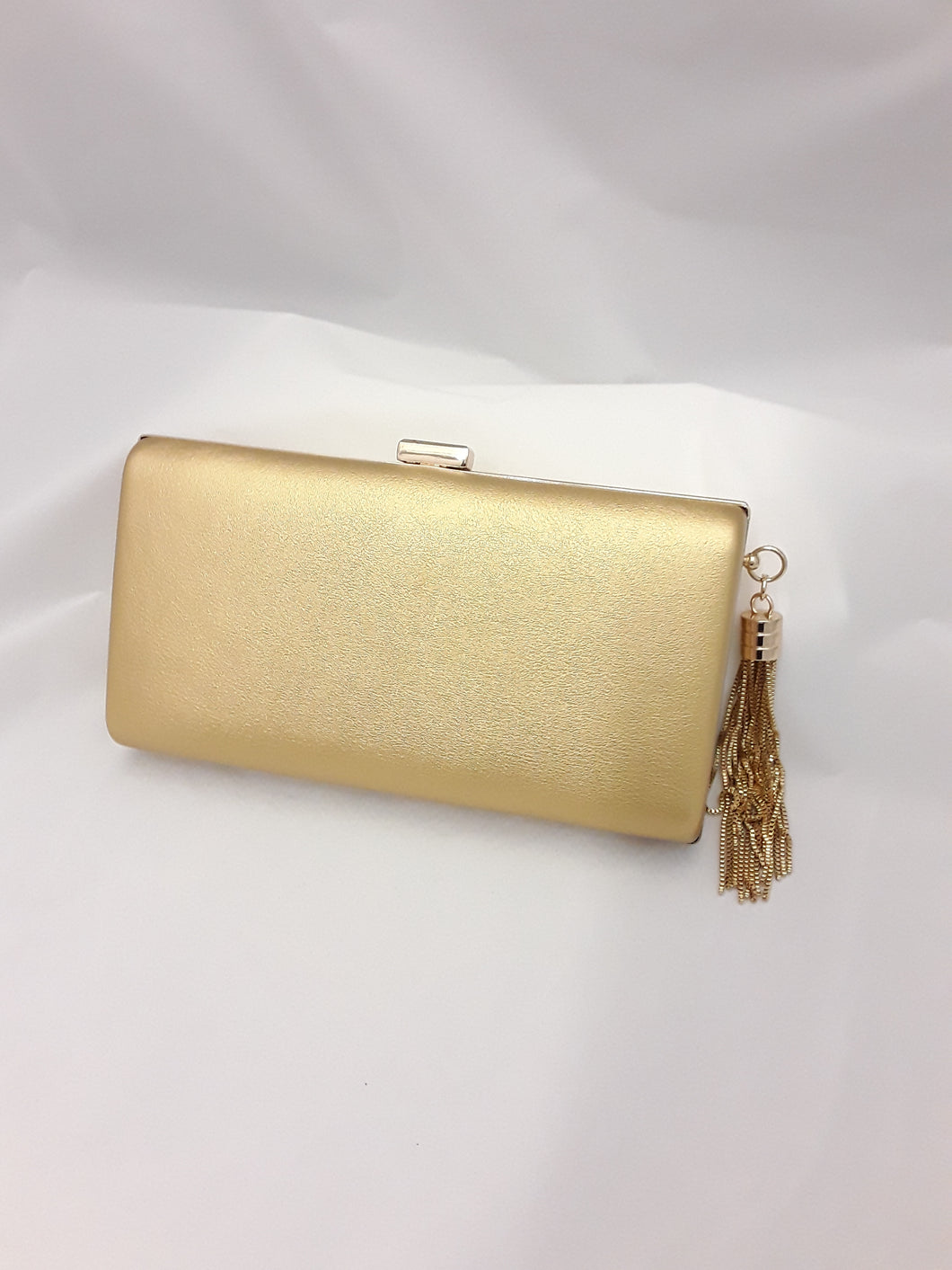 Gold matt clutch 779 with tassle