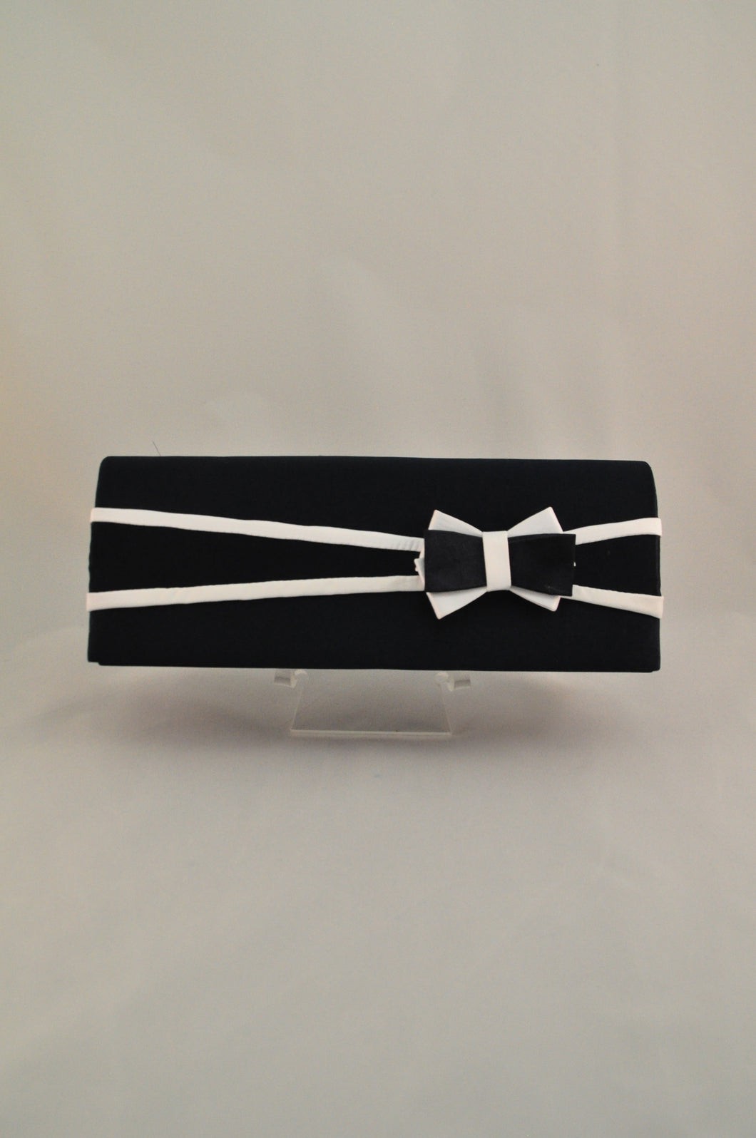 Black satin clutch with bow feature