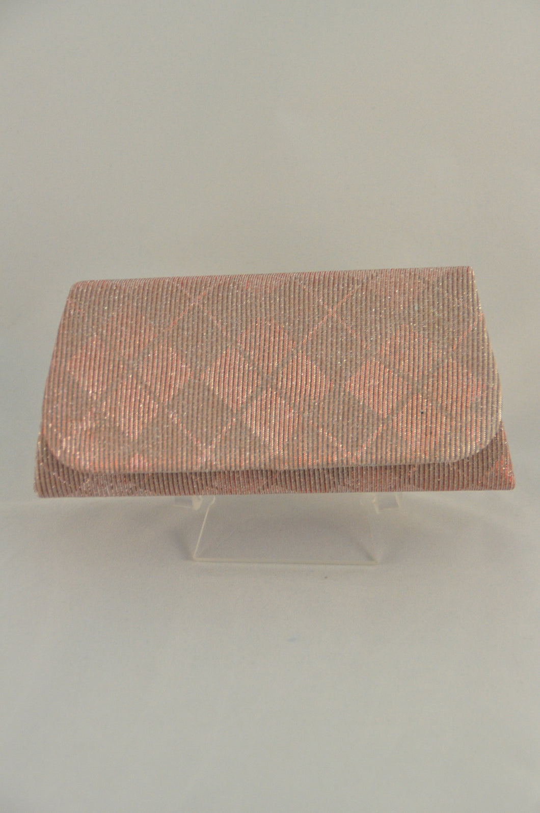 Rose gold clutch in metallic fabric