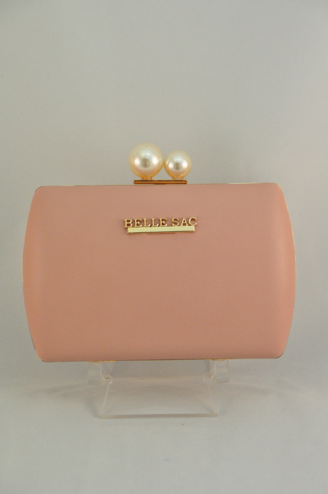 Pink nude clutch with gold trim and pearl clasp