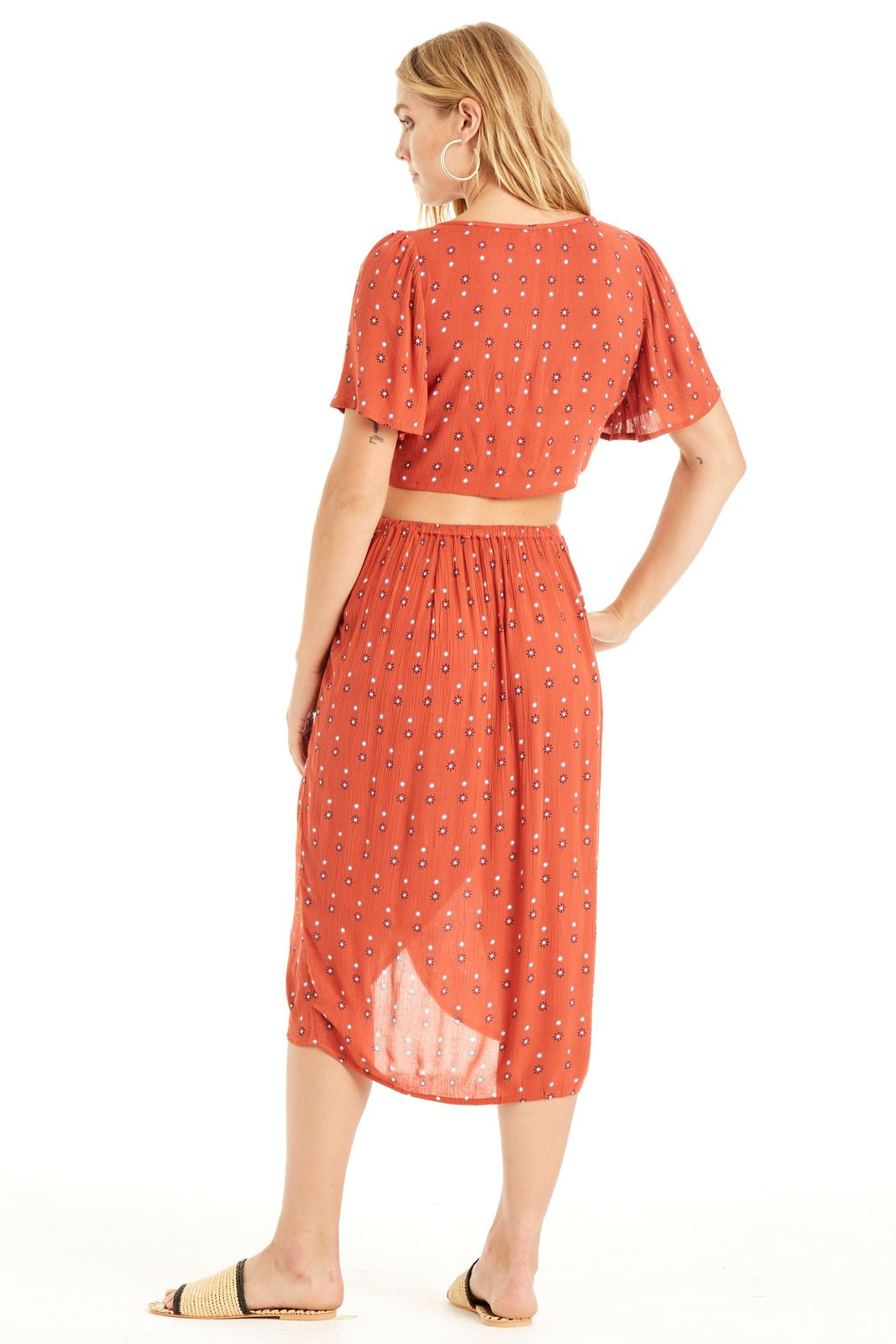 Dusty Terracotta  wrap skirt with polka dot and flower print, featuring button detailing.