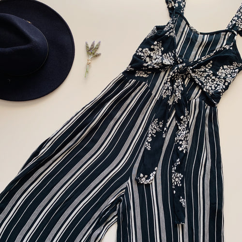 This navy featuring striped print and a self-tie flower print around the waist