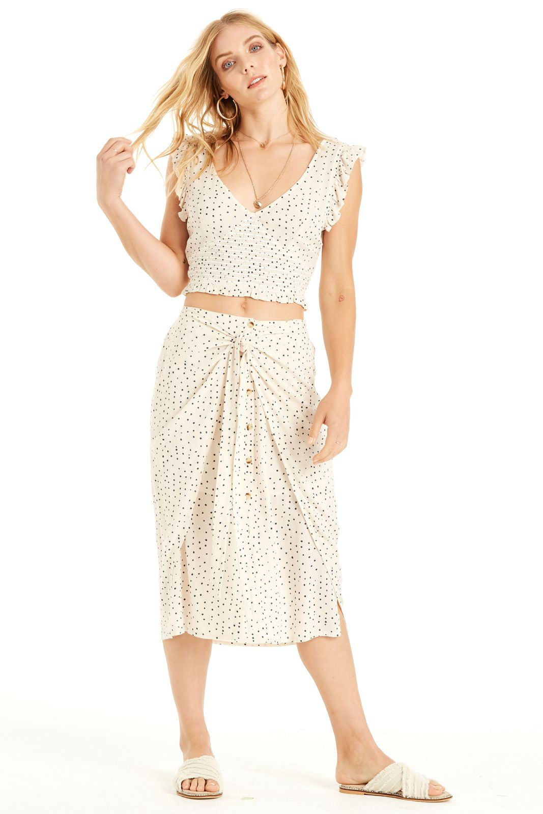 High waisted cream skirt with polka dot print. Featuring front tie with button detailing.