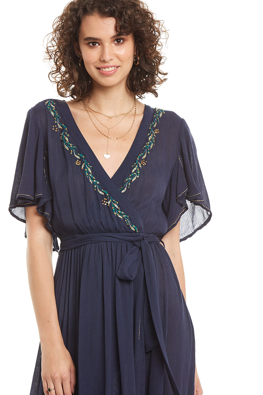 Dark Navy wrap dress with embroidery detail and colorful beading around the neckline