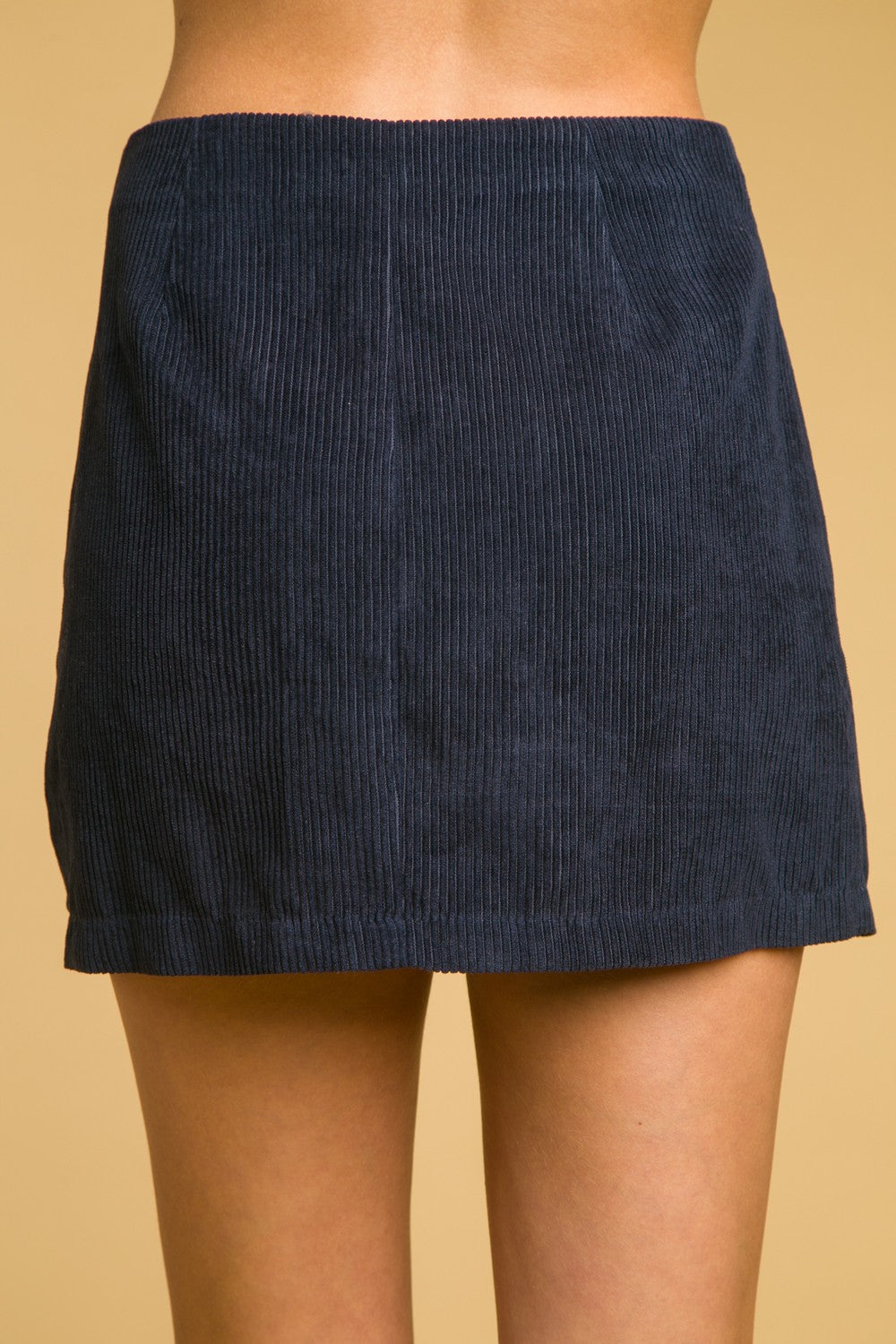 High waisted blue corduroy skirt with button detail.
