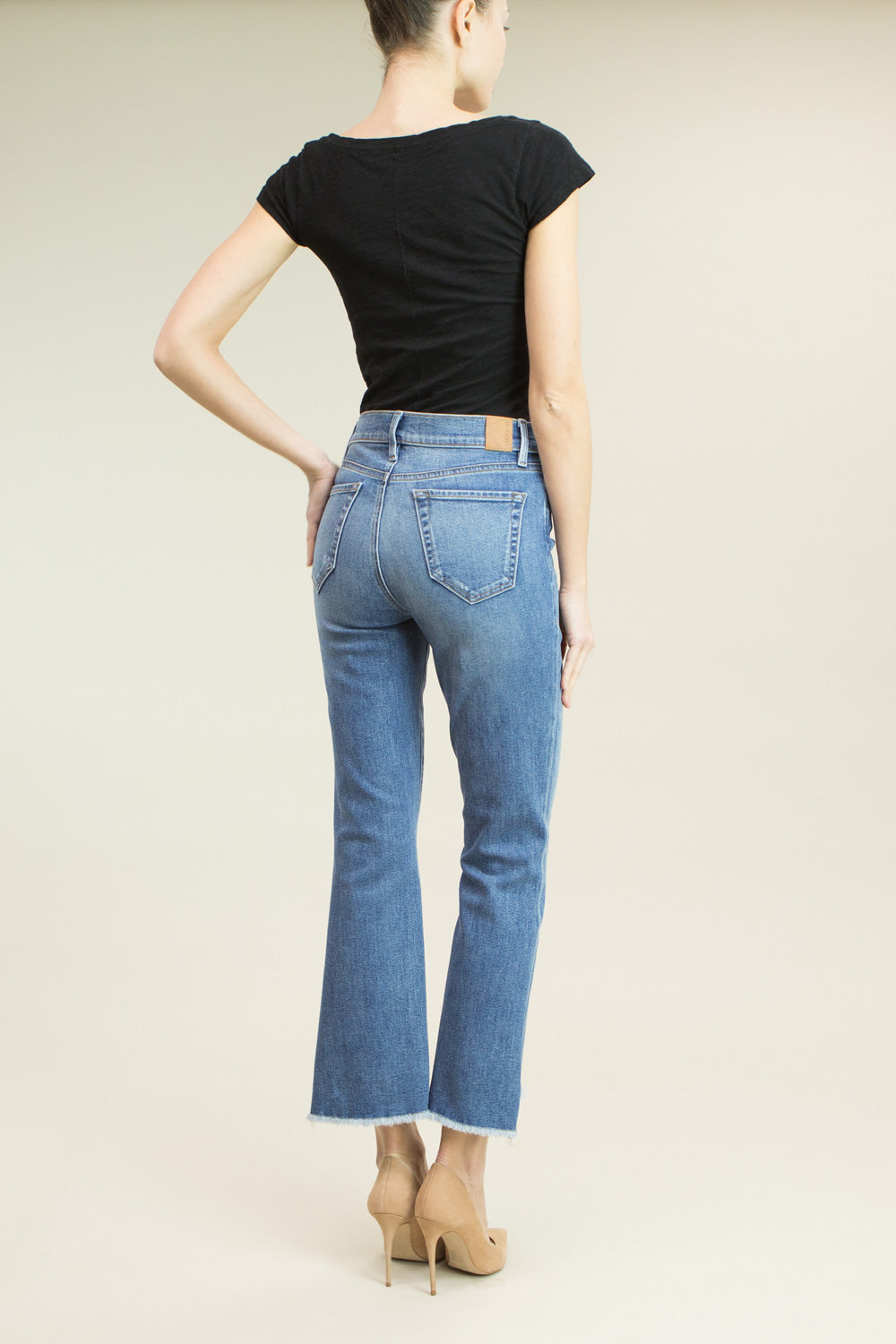 vintage blue wash high rise, straight leg style jean with frayed uneven hems.