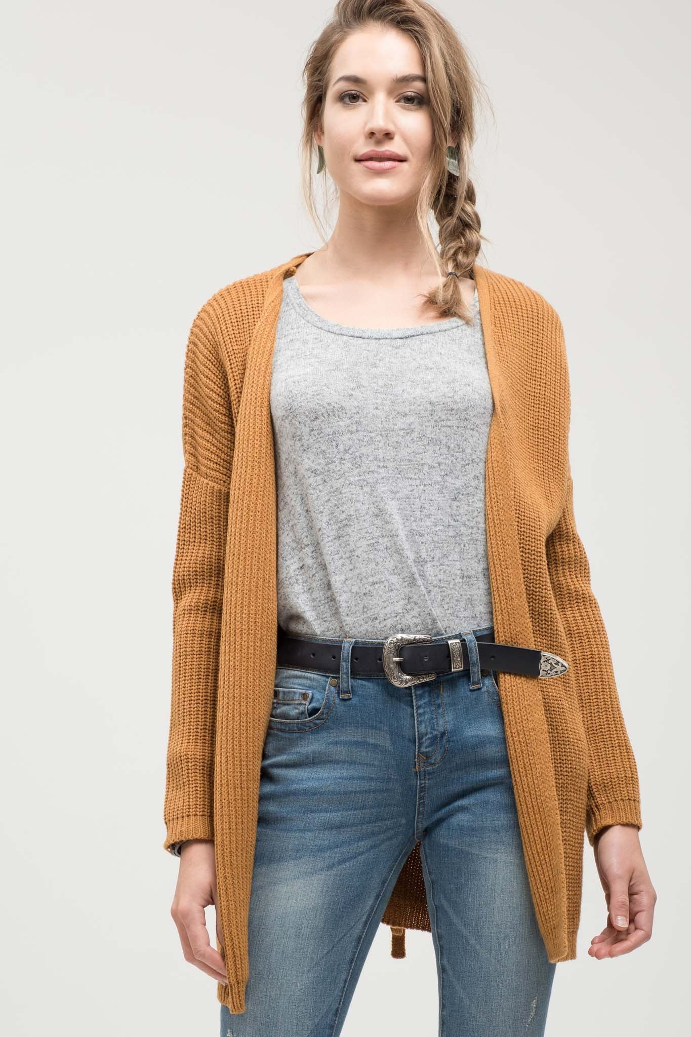 The Endless Summer Chunky Knit Mustard Cardigan features a cute lace up detail on the back.