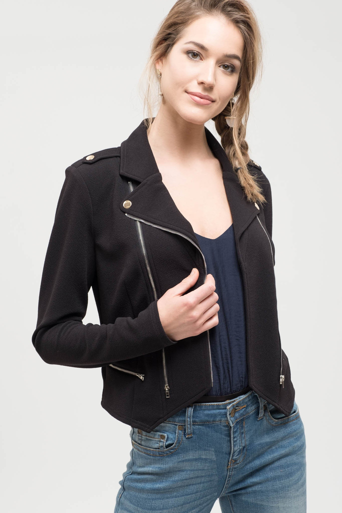 Solid black textured jacket with zipper detail.