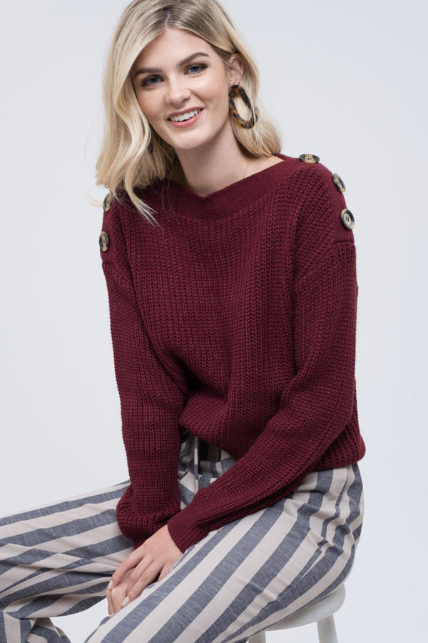 Solid cable knit pullover burgundy sweater with button detail on the shoulders.