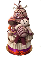crochet bear, beanie, wooden rattle diaper cake