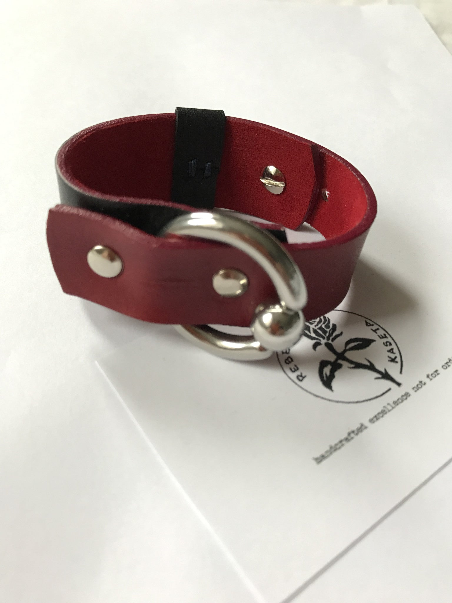 woman's leather wrist wrap  black / burgundy