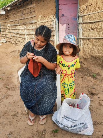 Two young Wayuu girls, one making a Wayuu bag