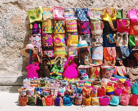 Wayuu Mochila bags from Colombia against a wall