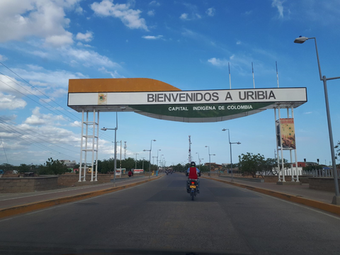 """Welcome to Uribia"" sign in Colombia"