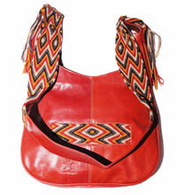 Red leather with red, orange, tan, and black crocheted decoration on a modern Wayuu bag