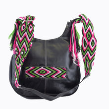 Black leather with pink, green, and white crocheted decoration on a modern Wayuu bag