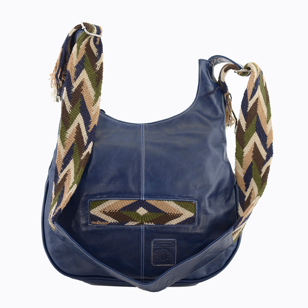 Dark blue leather with tan, blue, green, and brown crocheted decoration on a modern Wayuu bag