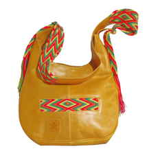 Light tan leather with rainbow-colored crocheted decoration on a modern Wayuu bag
