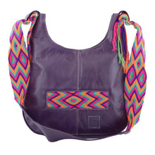 Purple leather with green purple, pink, and orange crocheted decoration on a modern Wayuu bag