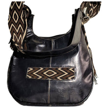 Black leather with brown, tan, and black crocheted decoration on a modern Wayuu bag