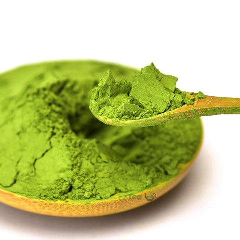 organic matcha green tea powder scooped