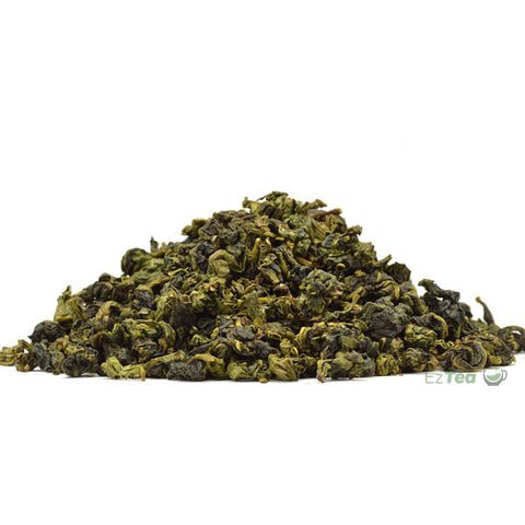 "Tie guan yin ""Iron Goddess"" Oolong loose leaf tea in a pyramid shape"