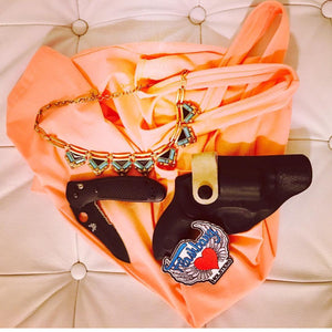 The Flashbang bra holster with knife and necklace flatly