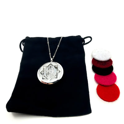 Palm Swirl Diffuser necklace with velvet polishing pouch