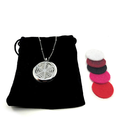 Radiant Star Diffuser necklace with velvet polishing pouch