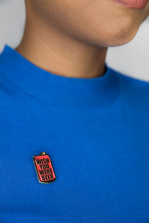wish-you-were-beer-enamel-pin-on-blue-shirt