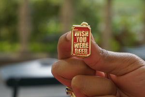 holding-wish-you-were-beer-enamel-pin