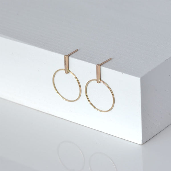 Round 14k yellow gold earrings