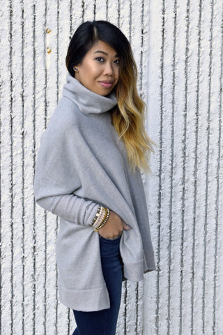 You're going to want to get a feel of the I Know The Feeling Grey Sweater! The gorgeous heather grey sweater is amazingly soft featuring turtleneck, long sleeves, slit sides and super cozy oversized fit.