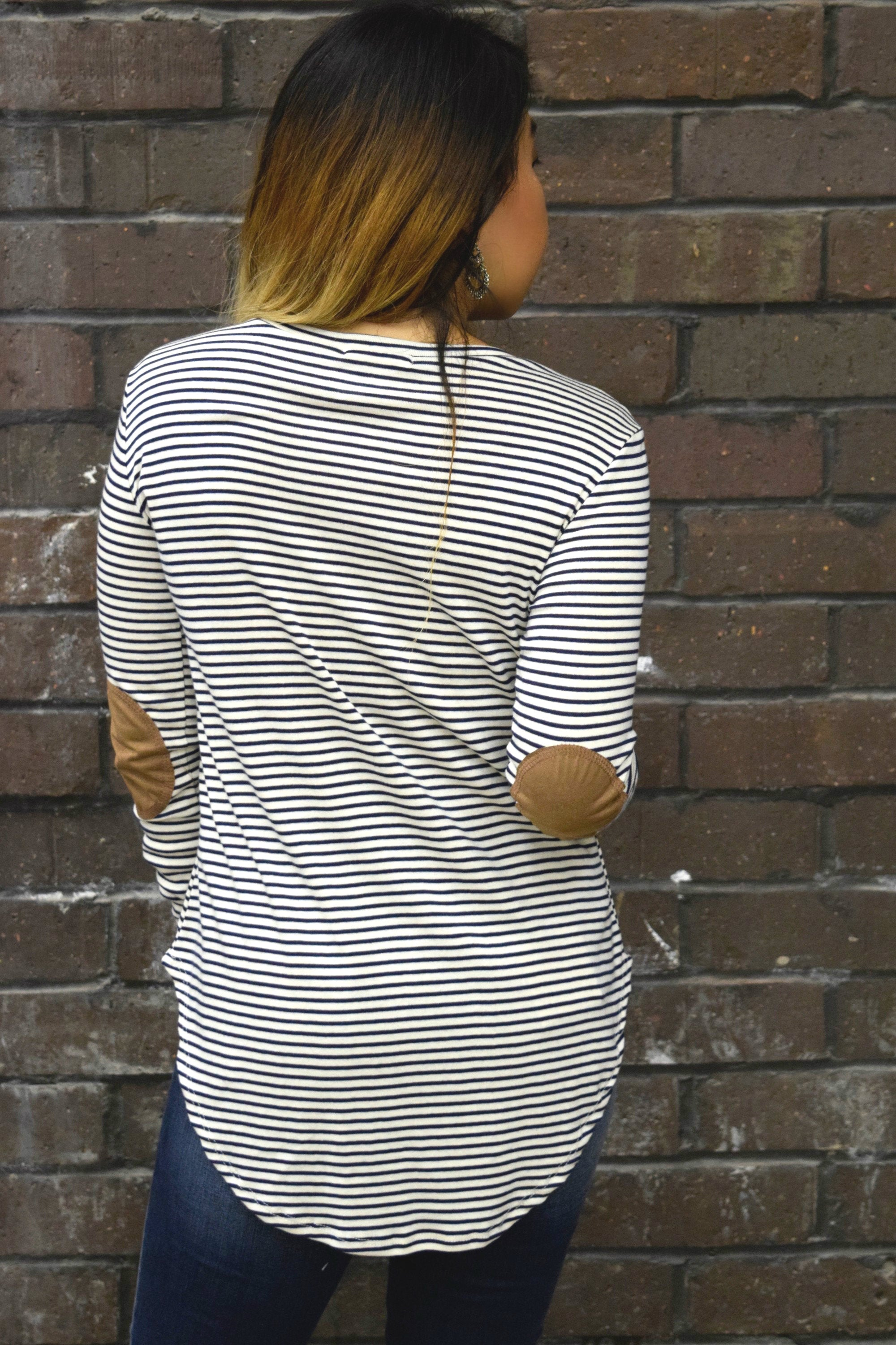 GOING THROUGH A SOFT PATCH STRIPED TOP