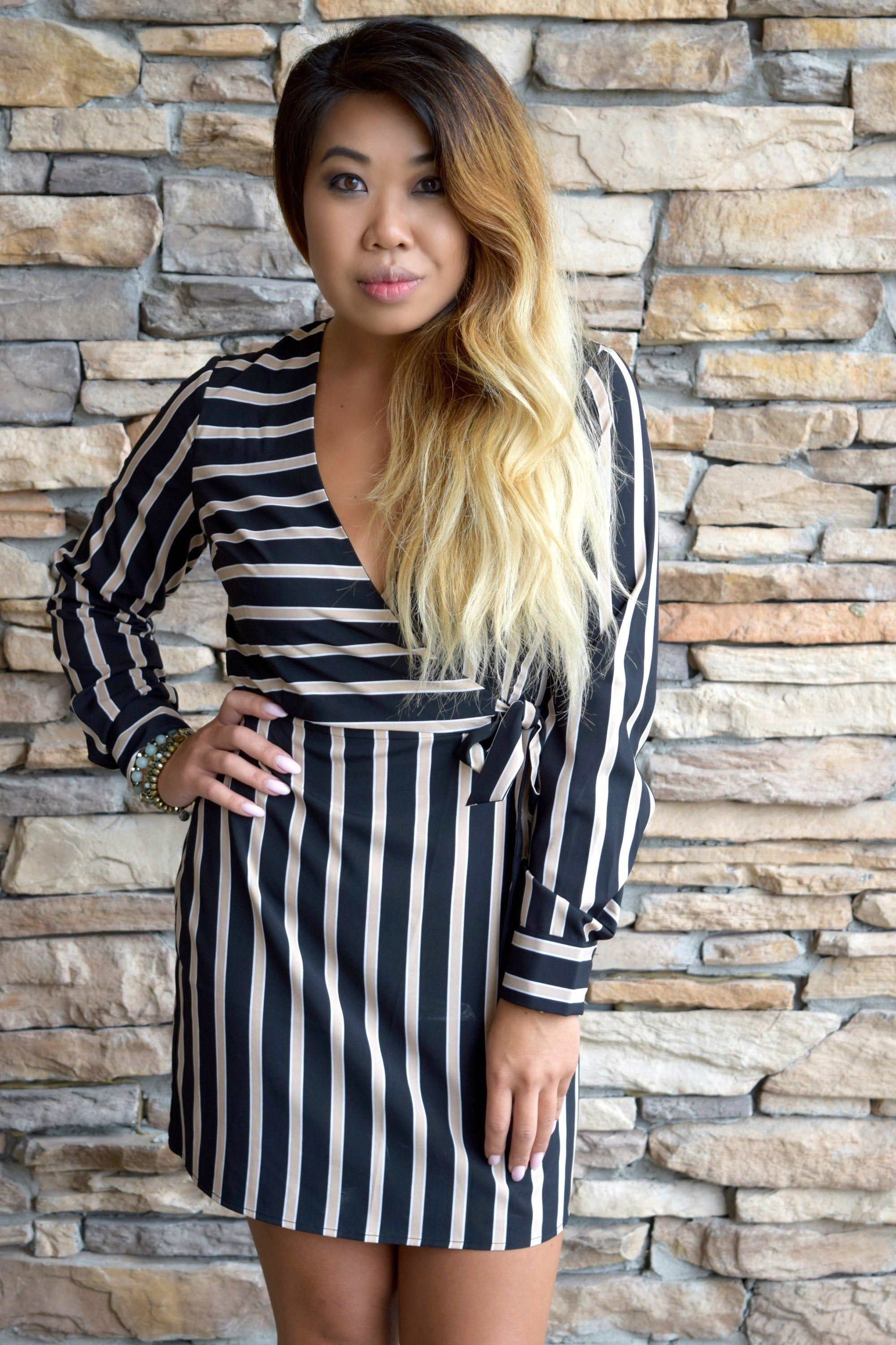 STATEMENT IN STRIPES BLACK WRAP DRESS